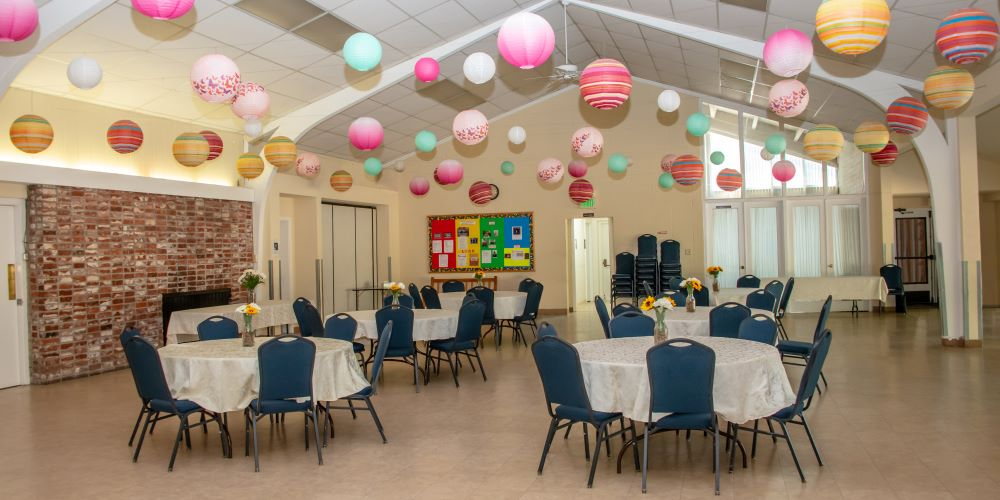 fellowship hall decorated with balloons
